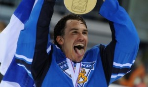 Finland's Sami Lepisto holds the IIHF Ice Hockey World trophy as he celebrate after winning gold medal in the IIHF Ice Hockey World Championship final match against Sweden in Bratislava on May 15, 2011. Finland won 6-1. AFP PHOTO/SAMUEL KUBANI