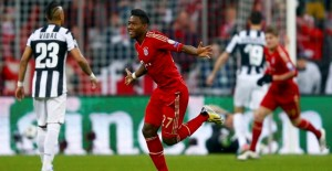 Bayern Munich's David Alaba (C) celebrates a goal against Juventus during their Champions League quarter-final first leg soccer match in Munich, April 2, 2013.     REUTERS/Kai Pfaffenbach (GERMANY  - Tags: SPORT SOCCER)