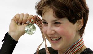 Irina Slutskaya of Russia shows off her gold medal on the podium during medal ceremonies at the World Figure Skating Championships at Luzhniki Sports Palace in Moscow, Saturday, March 19, 2005. Slutskaya won the gold medal Saturday at the women''s World Figure Skating Championships, capping a season in which she surged despite lingering heart problems. (AP Photo/Alexander Zemlianichenko) RUSSIA WORLD SKATING