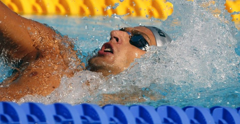 Stanislav Donets of Russia competes in the men's 200m backstroke swimming heats at the World Championships in Rome July 30, 2009.     REUTERS/Wolfgang Rattay   (ITALY SPORT SWIMMING)