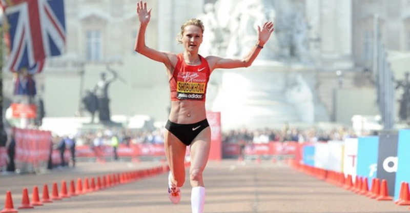Liliya Shobukhova of Russia crosses the finish line to come in second during the women's section of the London marathon April 17, 2011. REUTERS/Paul Hackett  (UNITED KINGDOM - Tags: SPORT ATHLETICS)