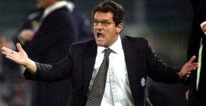 ** FILE ** Juventus coach Fabio Capello shouts indications to his players during the Italian first division soccer match between Juventus and Lazio, at the Turin delle Alpi stadium, in this Sunday, Dec. 5, 2004 file photo.  It is being reported in the British media that Capello is close to being offered a contract to become the new coach of the English national soccer team. (AP Photo/Massimo Pinca)