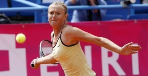 Maria Sharapova of Russia returns a shot against Regina Kulikova of Russia during the Strasbourg International tennis tournament May 17, 2010.   REUTERS/Jean-Marc Loos  (FRANCE - Tags: SPORT TENNIS)