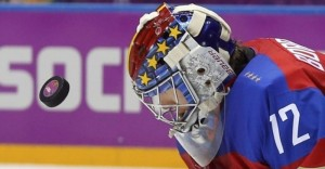 Russia's goalie Sergei Bobrovski makes a save against Norway during the second period of their men's qualification round ice hockey game at the 2014 Sochi Winter Olympic Games, February 18, 2014. REUTERS/Mark Blinch (RUSSIA  - Tags: OLYMPICS SPORT ICE HOCKEY)