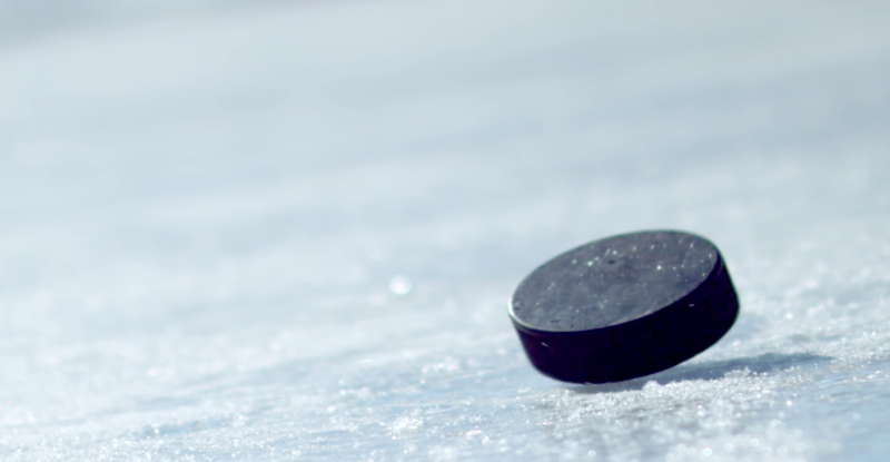 hockey-puck-falling-onto-ice-and-being-picked-up-by-a-gloved-hand_njdp2y_o__F0000